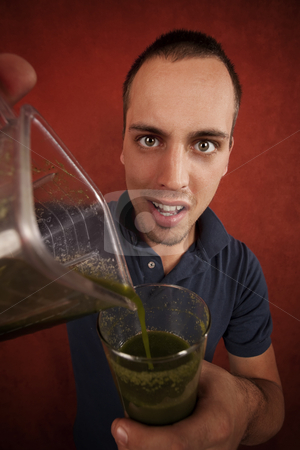 Young man with unappetizing health shake stock photo, Young man holding unappetizing blended health shake by Scott Griessel