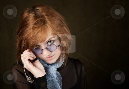 Pretty Girl with Blue Glasses stock photo, Pretty teenage girl with round blue sunglasses by Scott Griessel