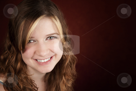 Teen girl with green eyes stock photo, Portrait of pretty teen girl with green eyes by Scott Griessel