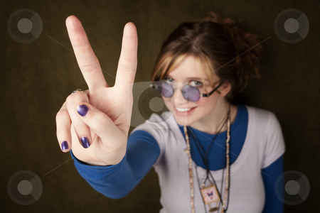 Girl Making Peace Sing stock photo, Pretty teen girl making a peace sign with her hand by Scott Griessel