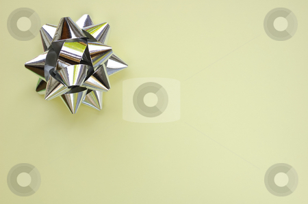 Star on cream stock photo, A decorative star, made from silver ribbon, on a plain cream background with space for text (copy). by Alistair Scott
