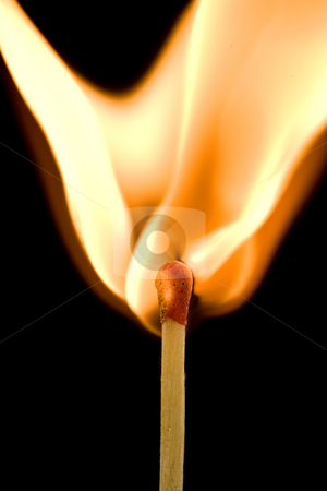 Igniting match stock photo, Macro of an ignited matchstick flame in the dark by Laurent Renault