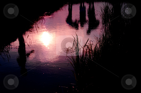 Happiness Moment stock photo, Silhouette watter reflection of family happiness moment at sunset by Pawee Lorsuwannarat