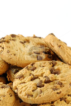 Cookie pile stock photo, Close-up of a pile of delicious chocolate chip cookies by Paul Turner