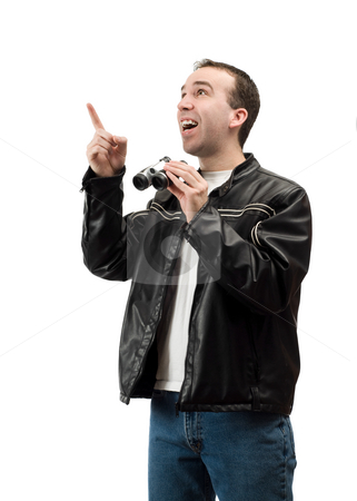Pointing stock photo, A young man pointing at some blank space while holding a set of binoculars, isolated against a white background by Richard Nelson