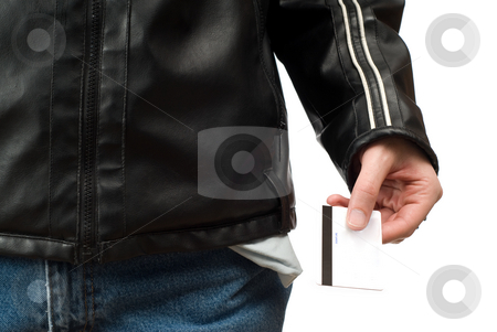 Going Into Debt stock photo, A broke man with empty pockets is holding out a credit card and going into debt, isolated against a white background by Richard Nelson