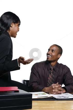 Business Colleagues Laughing stock photo, Male and female business colleagues laughing as they chat together. Vertical shot isolated against a white background. by Orange Line Media