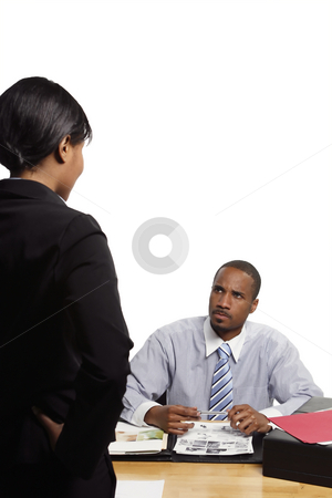 Angry Boss stock photo, Seated boss looking angry as a female subordinate gives him some news. Vertical shot isolated on white by Orange Line Media