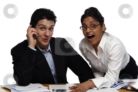 Teamwork - Surprised stock photo, Businesswoman standing helping her male colleague who's seated.  Both are looking at the camera.  Shot horizontal isolated on white. by Orange Line Media