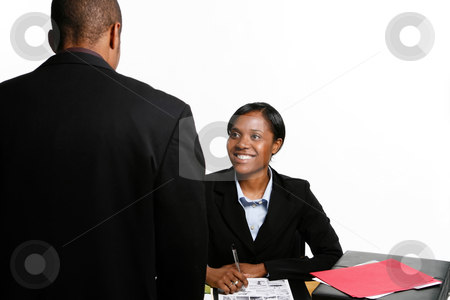 Smiling Business Colleagues stock photo, Male and female business colleagues chatting and smiling. Horizontal shot, isolated against a white background by Orange Line Media