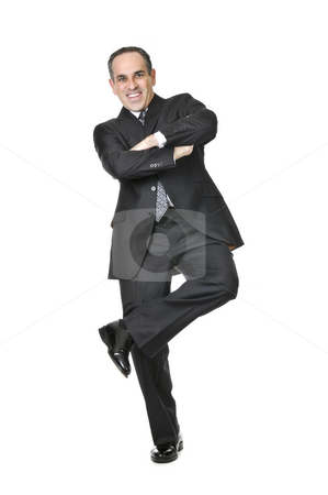 Businessman on white background stock photo, Happy businessman in a suit standing on one leg isolated on white background by Elena Elisseeva