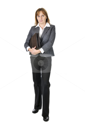 Businesswoman on white background stock photo, Serious businesswoman holding a portfolio isolated on white background by Elena Elisseeva