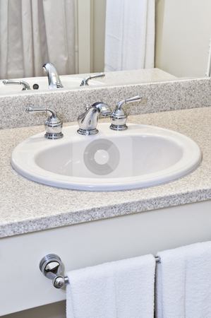 Bathroom sink stock photo, Bathroom interior with white sink, faucet and mirror by Elena Elisseeva