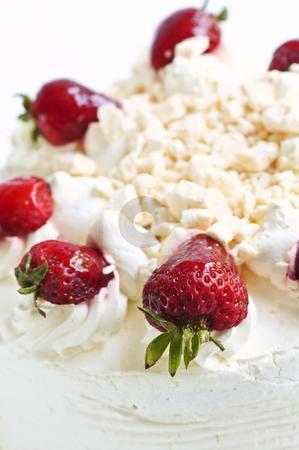 Strawberry meringue cake stock photo, Strawberry meringue cake close up on white background by Elena Elisseeva