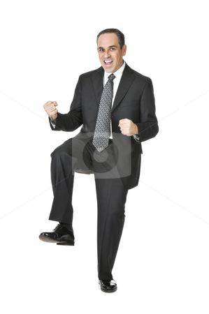 Businessman on white background stock photo, Triumphant businessman in a suit isolated on white background by Elena Elisseeva