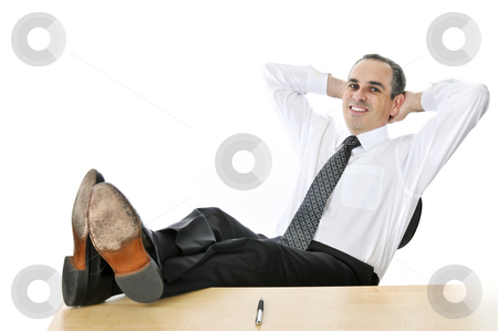 Relaxing businessman stock photo, Relaxing businessman with feet up on his desk by Elena Elisseeva