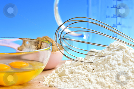 Baking stock photo, Flour, whisk and eggs in a bowl, baking ingredients by Elena Elisseeva