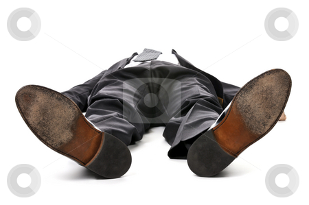 Businessman laying down on white background stock photo, Businessman laying down in a suit isolated on white background by Elena Elisseeva
