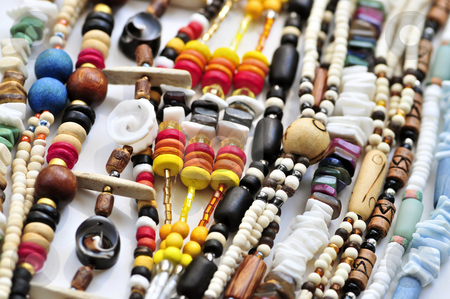 Wood and seashell bead necklaces stock photo, Wood and seashell bead necklaces close up by Elena Elisseeva