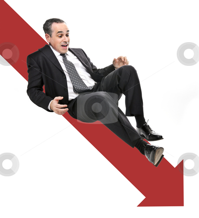 Businessman sliding down red arrow stock photo, Businessman sliding down red arrow in financial crisis by Elena Elisseeva