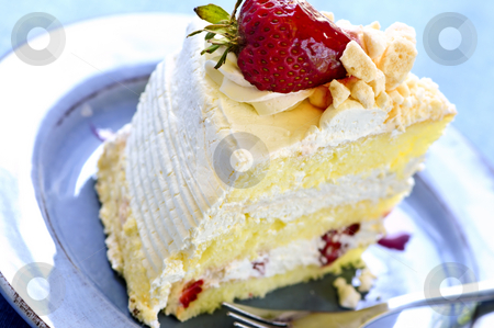 Slice of strawberry meringue cake stock photo, Slice of strawberry meringue cake on a plate by Elena Elisseeva
