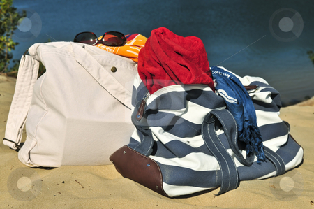 Beach bags stock photo, Summer beach bags on sand with towels and sunglasses by Elena Elisseeva