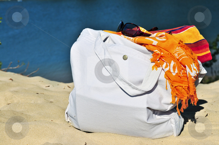 Beach bags stock photo, Summer beach bag on sand with towels and sunglasses by Elena Elisseeva