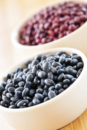 Black and red adzuki beans stock photo, Dry black and red adzuki beans in bowls by Elena Elisseeva