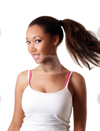 Young black woman swinging pony tail smiling stock photo, Young black woman smiling with braces upper teeth by Jeff Cleveland
