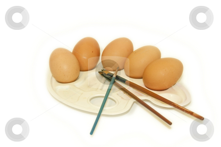 Eggs on a palette stock photo, Eggs displayed on a palette with paint brushes, isolated on a white background by Chris Alleaume