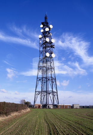 Communicating stock photo, Mast with white dishes used for transmitting by Paul Phillips