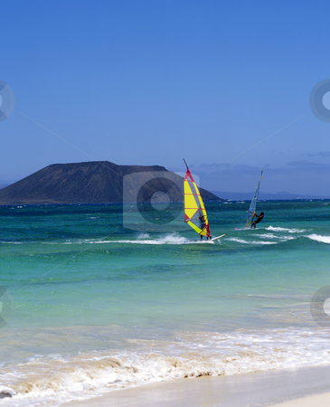 Gran Canaria windsurfing stock photo, Gran Canaria windsurfing with a smill island in the background by Paul Phillips