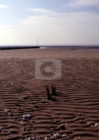Ripples in the sand stock photo, Coastline with dark brown sand forming ripples and a pattern by Paul Phillips