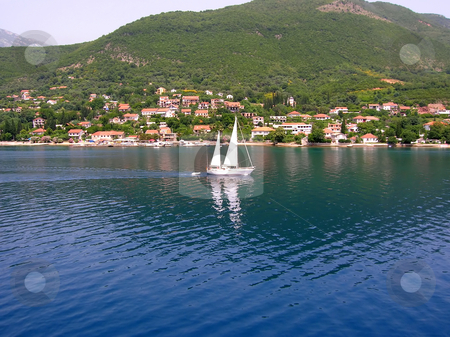 Sailing boat over blue water stock photo, White sailing boat over blue adriatic sea in montenegro by Julija Sapic