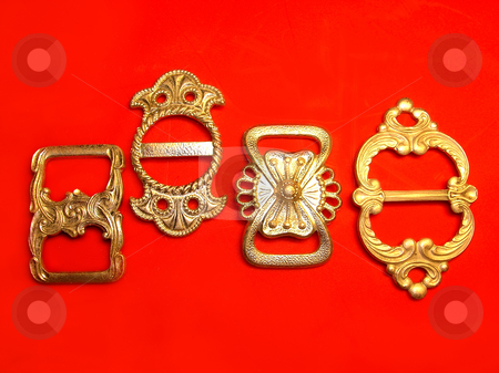 Accessories stock photo, Four silver buckles over red background by Julija Sapic