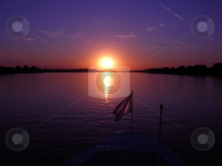 Purple sunset stock photo, Purple sunset over dark river from boat by Julija Sapic