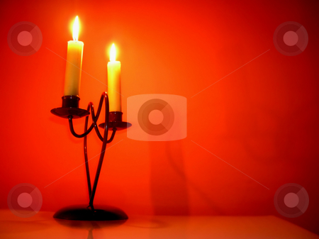 Candles over orange stock photo, Two burning candles on candlestick over orange by Julija Sapic