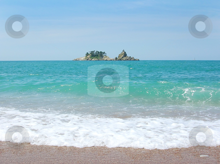 Small Island in adriatic sea stock photo, Small Island on horizon over water in adriatic sea in Montenegro by Julija Sapic