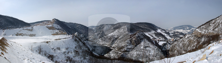 Winter Hills Panorama stock photo, View at snow covered hills with overcast sky. by Denis Radovanovic