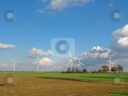Windmill park stock photo, Windmill park on a green meadow with blue sky by Karin Claus