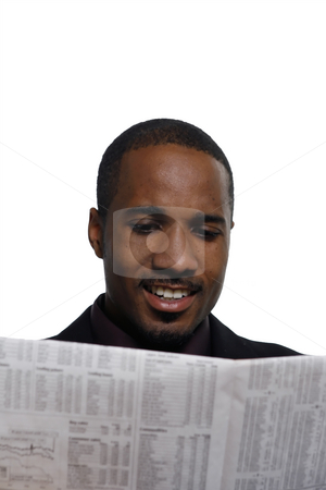 Man Smiling - Vertical stock photo, Man smiling while reading the paper. Vertical shot, isolated against a white background by Orange Line Media