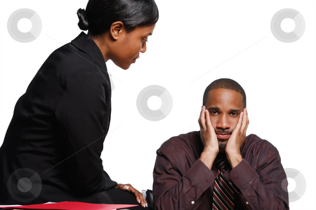 Business Colleagues stock photo, Male and female businesspeople interacting. She is sitting on the desk talking to him and he has his face in his hands looking fed up. Isolated against a white background by Orange Line Media