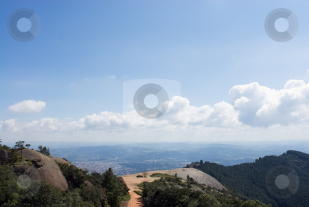 Looking Down from a Mountain into Valley stock photo, Outdoors looking down from a mountain into valley in Brazil. by Orange Line Media