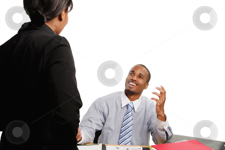 Happy Boss stock photo, Seated boss smiling broadly as a subordinate delivers some news. Isolated on white. by Orange Line Media
