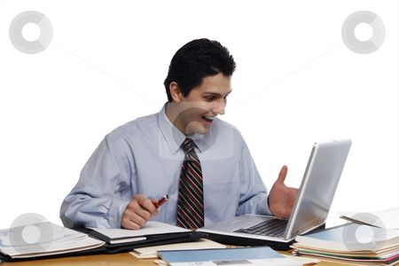 Alright! stock photo, Young businessman looking overjoyed at his laptop computer.  Shot horizontal isolated on white. by Orange Line Media