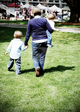 Mother and Sons stock photo, Young mother and her two cute sons walking in the park on a sunny day by Orange Line Media