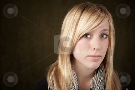 Close up of pretty blonde woman stock photo, Close up of blonde girl focusing on her blue eyes by Scott Griessel