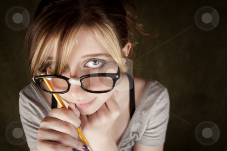 Closeup of Pretty Young Nerdy Girl stock photo, Portrait of nerdy teen girl with green eyes by Scott Griessel