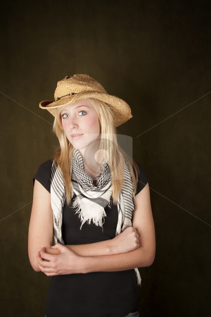 Pretty boldne teenager in a cowboy hat stock photo, Blonde teenager wearing a straw cowboy hat by Scott Griessel