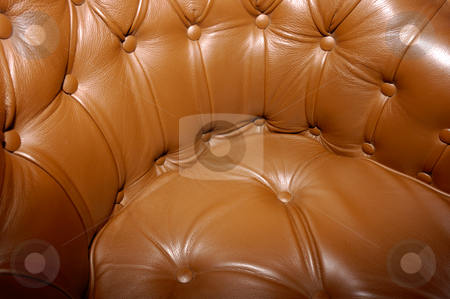 Brown leather seat. stock photo, Close-up of a seat upholstered in rich brown leather. by Alistair Scott
